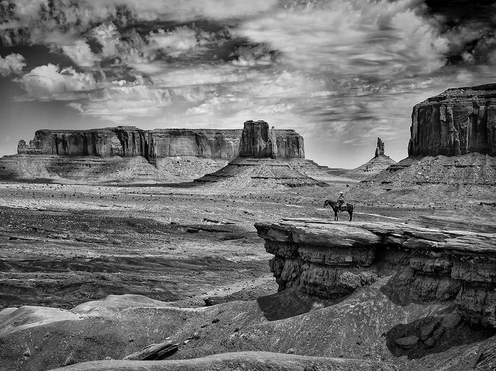 Picture of a cowboy on horseback in Monument Valley, Utah