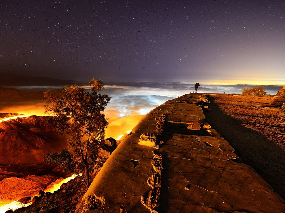 Picture of a person overlooking a cloudy vista at night, Saudi Arabia
