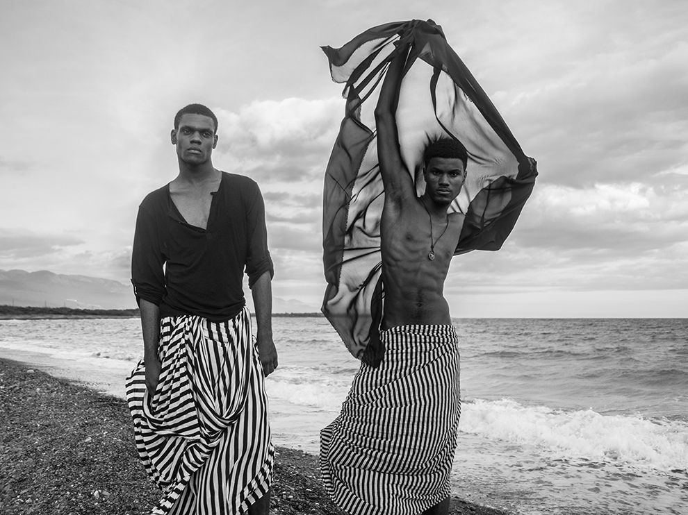 Picture of two male models walking along the beach, Port Royal, Jamaica