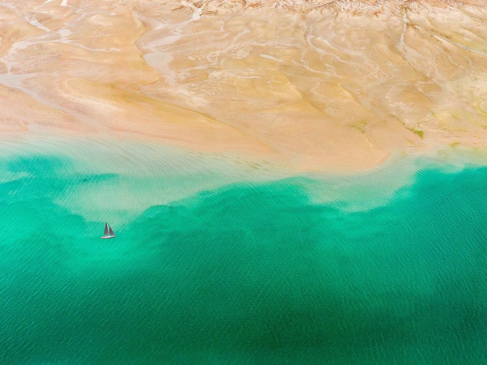 Aerial picture of land meeting sea near Dubai
