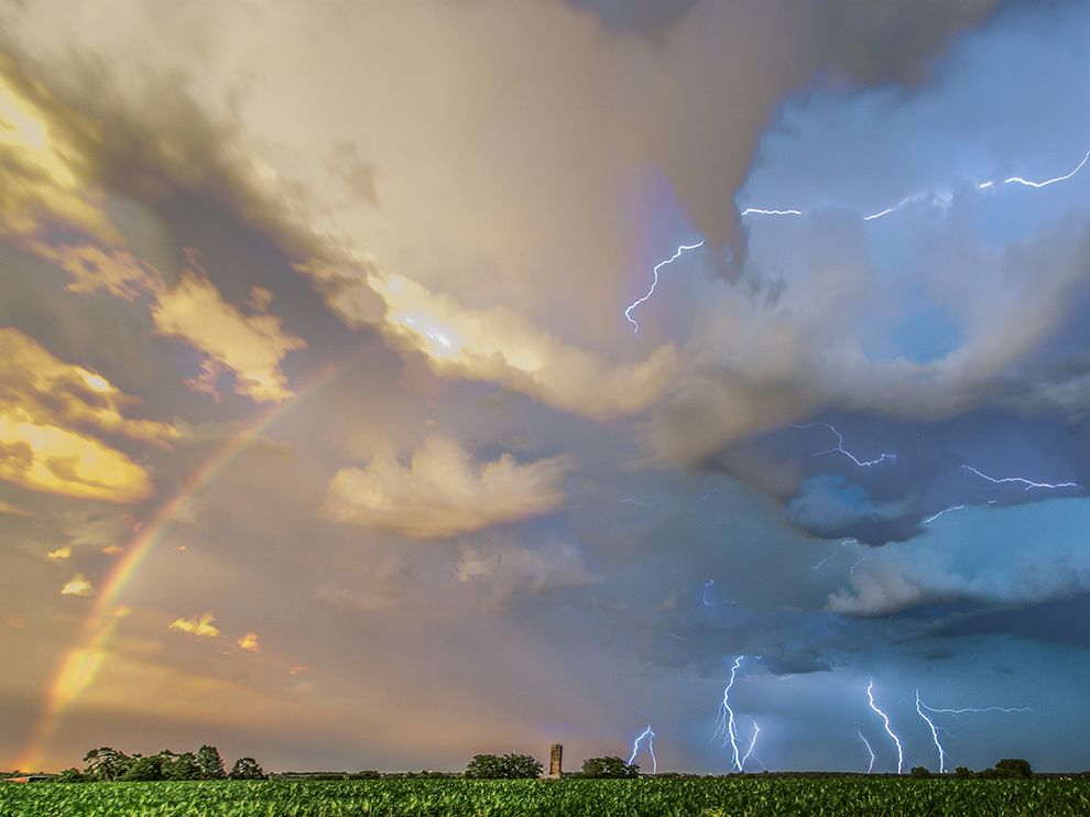Picture of lightning and a rainbow during a storm in Iowa