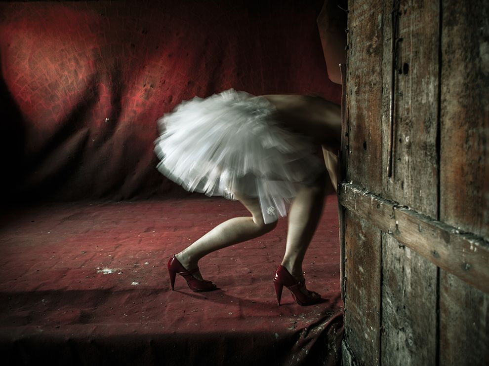 Picture of a woman in the attic in a tutu