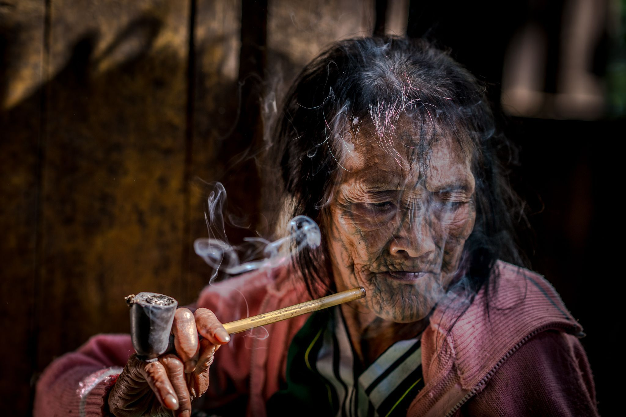 "An elderly woman in Myanmar is one of the last of her tribe to have intricate facial tattoos. ""The tribes first began to ink their faces as a way of disfiguring their beauty, to make themselves unattractive in hopes that by doing so, they could avoid being kidnapped or chosen as concubines by the Burmese kings,"" explains Your Shot photographer Han Lin Teh. ""The process of the facial tattooing is extremely painful, especially on the tender eyelid areas, and dangerous, as some even died of infection. It has been outlawed since 1960s."""