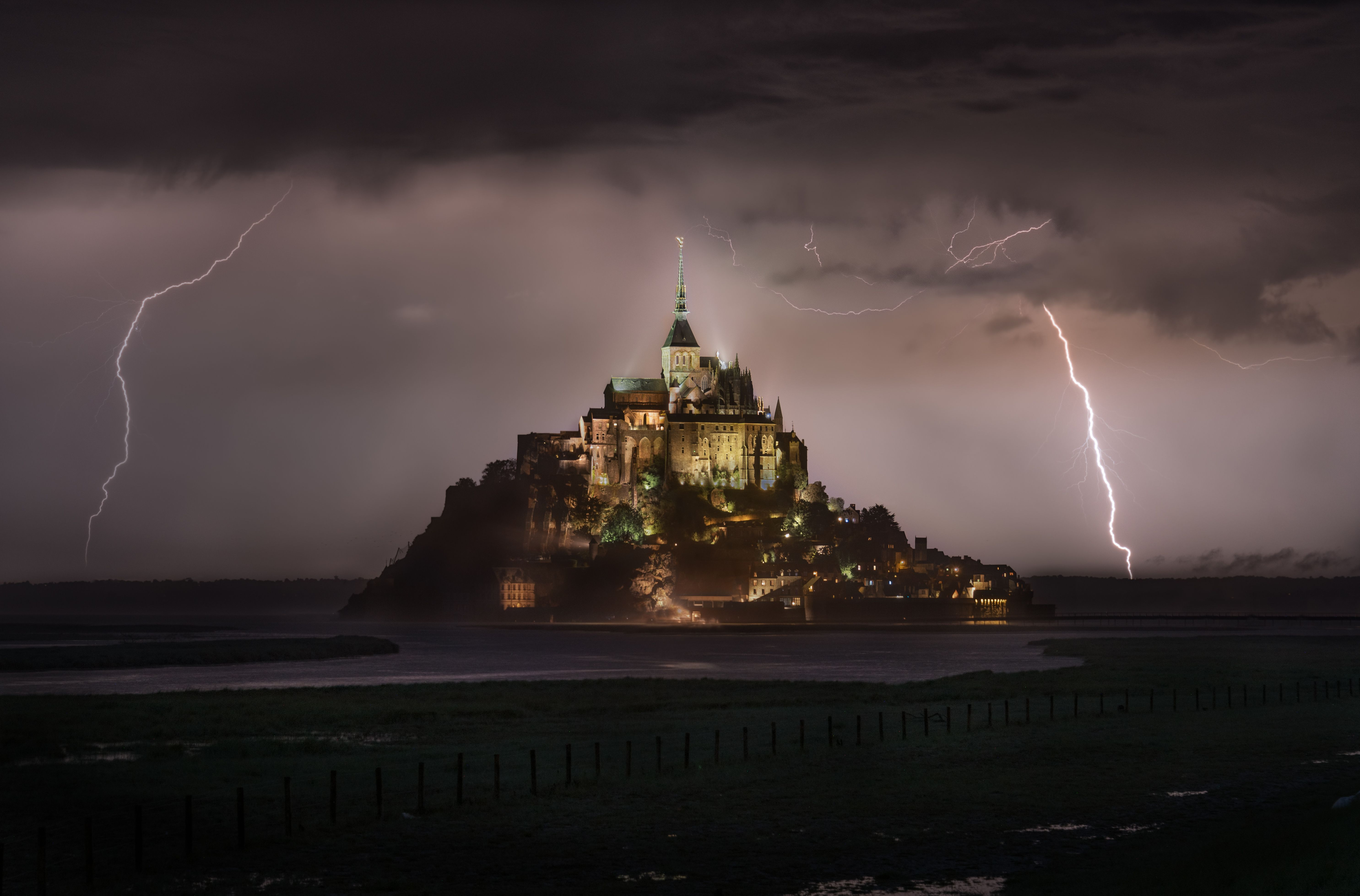"Your Shot photographer Lukas Neuwirth was on his way to photograph Mont-Saint-Michel at sunset when he was caught in a downpour. After the rain stopped, he set up his tripod and captured this scene of lightning striking around the island. ""It was amazing to witness this spectacular sight and mood!"" he remembers."