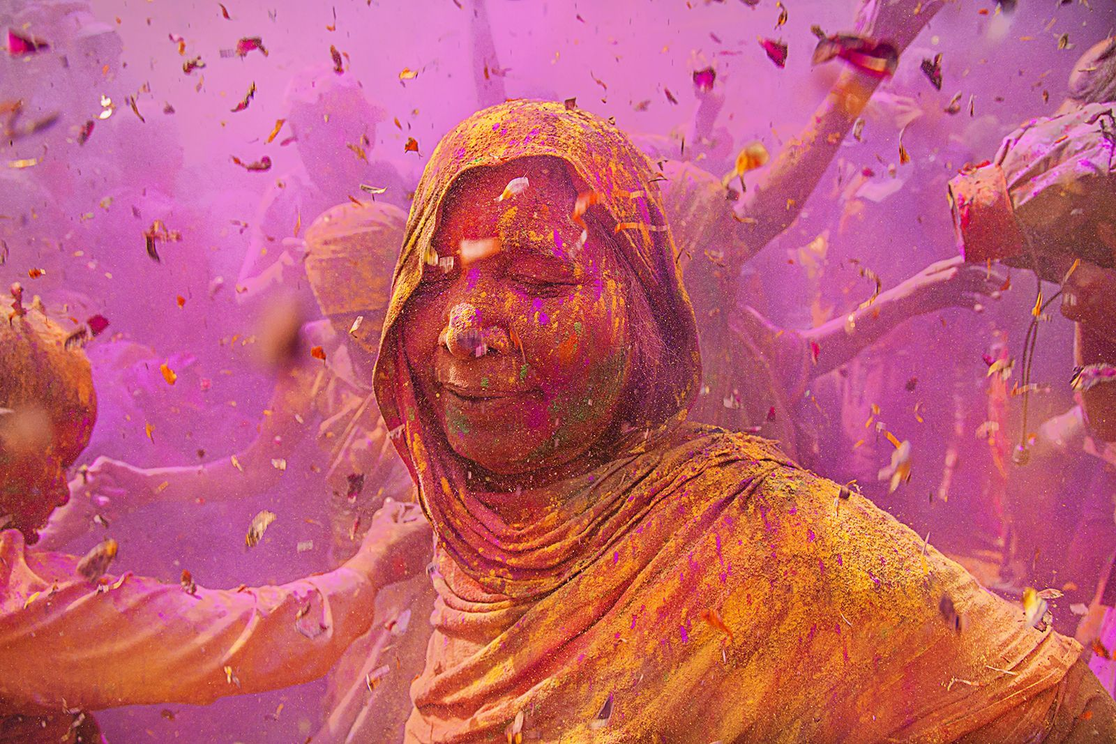 "During a Holi festival in India, a woman savors the colorful celebration. Holi is an annual Hindu festival that celebrates the end of winter and the coming of spring. Participants spray each other with water and colored powders, and also enjoy singing, dancing, and exchanging sweets. Your Shot photographer Lopamudra Talukdar says of women enjoying the festivities, ""The spirit is up and the guard is down."""