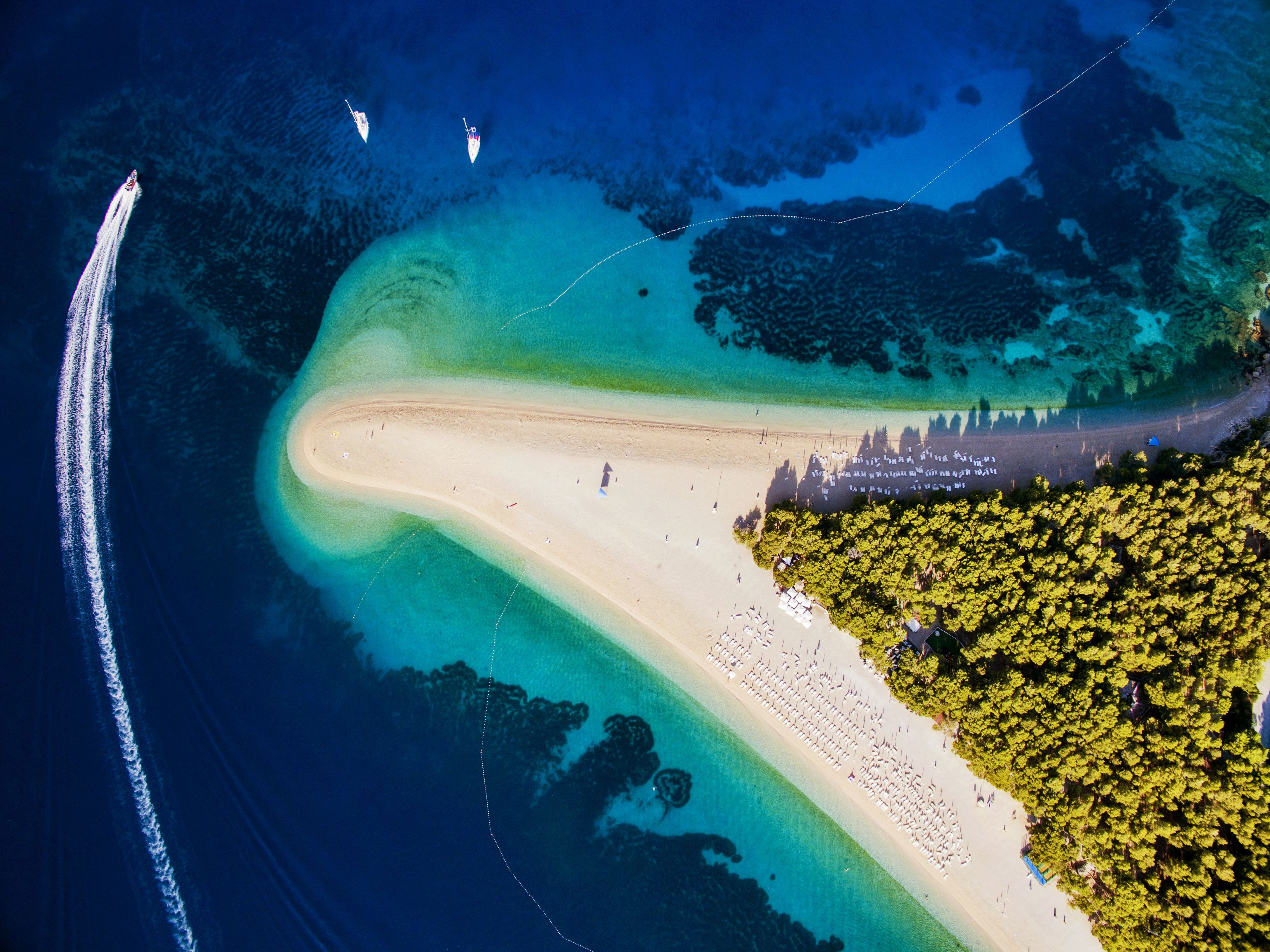 An aerial photo shows the bright colors that make up Croatia's Zlatni Rat, or Golden Cape. The sandy spit of land is often named one of Europe's best beaches.