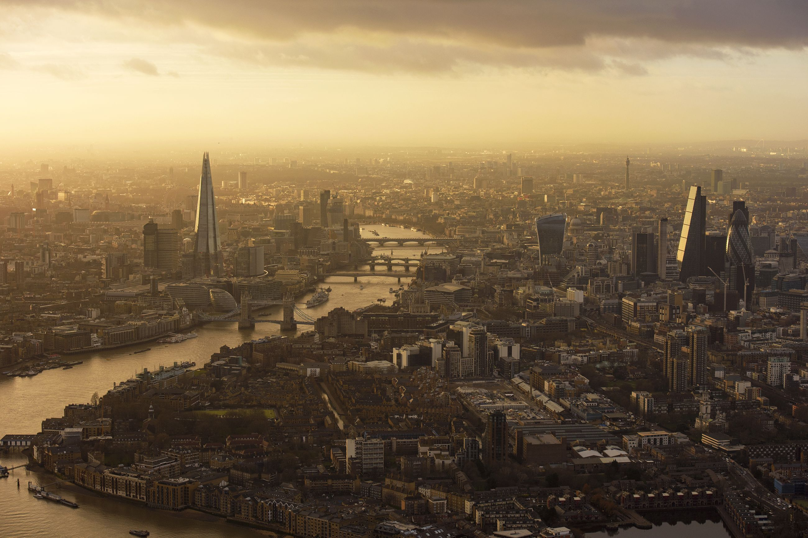 A haze covers London during golden hour one January day. The tall building on the left is known as The Shard. At 95 stories high, it's the tallest building in the United Kingdom.