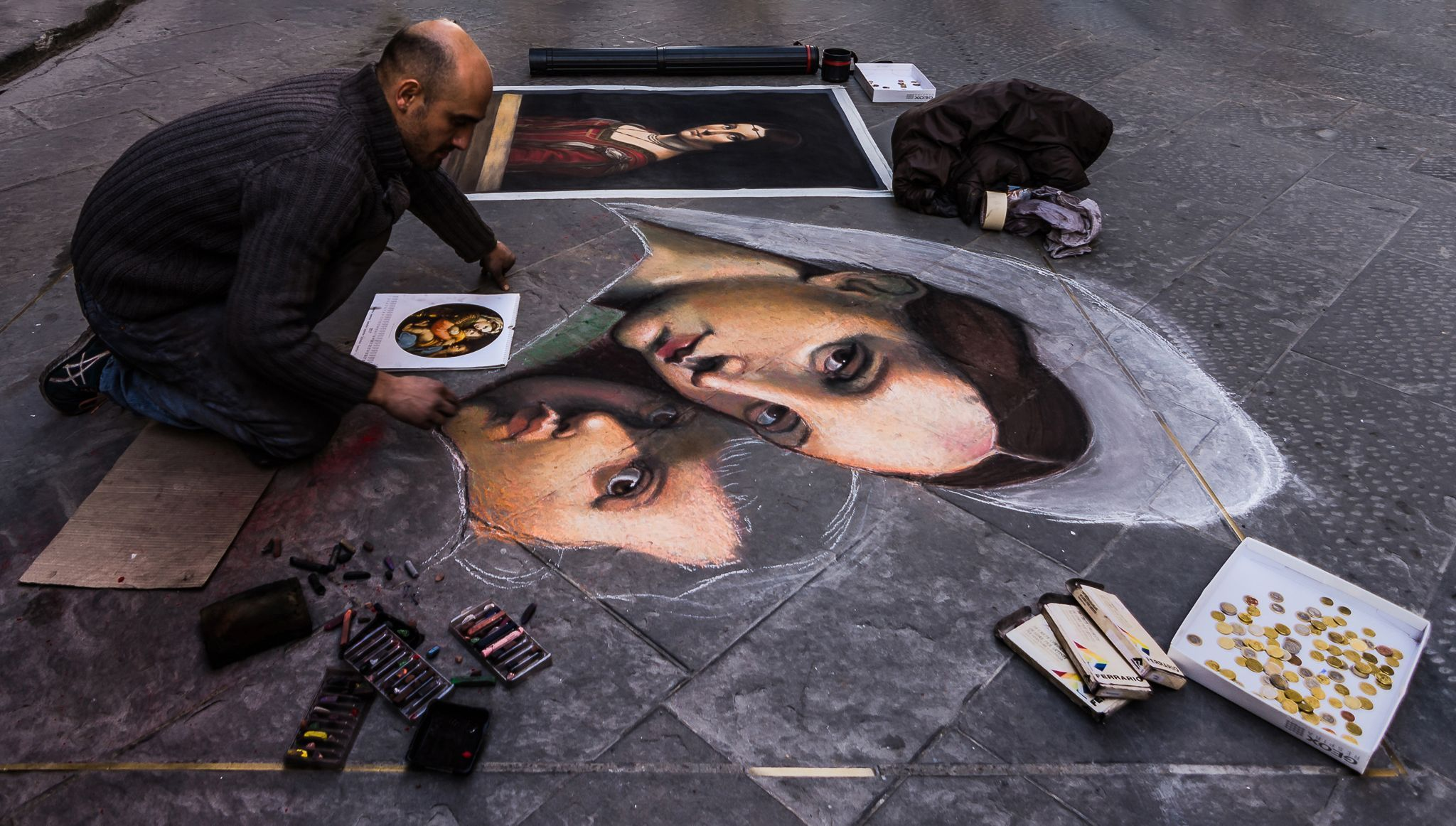In Florence, Italy, a chalk artist makes the sidewalk his canvas. He creates his portraits near the Uffizi Museum, famous for housing works by Michelangelo, da Vinci, and Botticelli.
