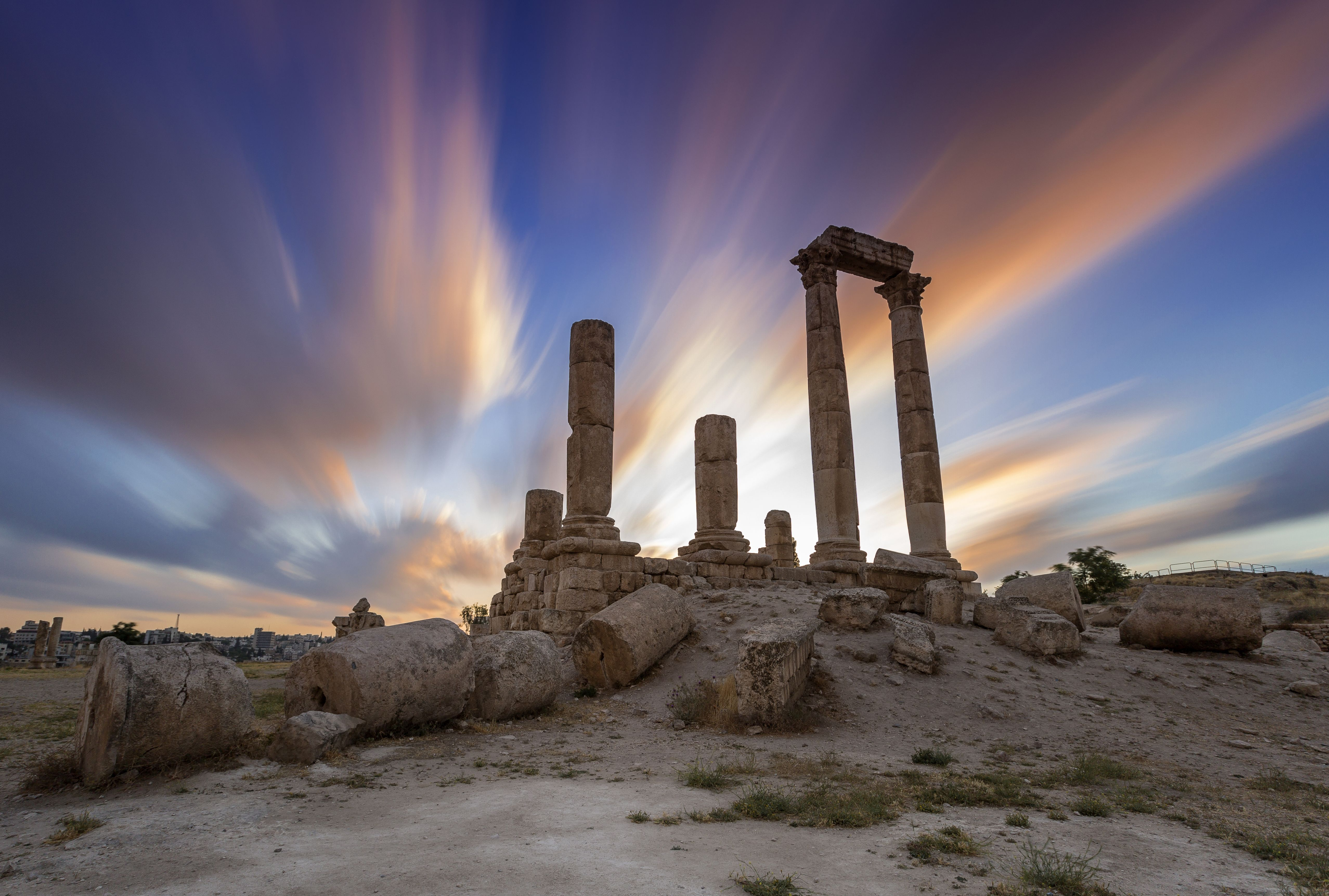 The sun sets behind the Temple of Hercules on the Amman Citadel in Jordan. An inscription on the marble indicates that the temple was constructed in the year 162 AD.